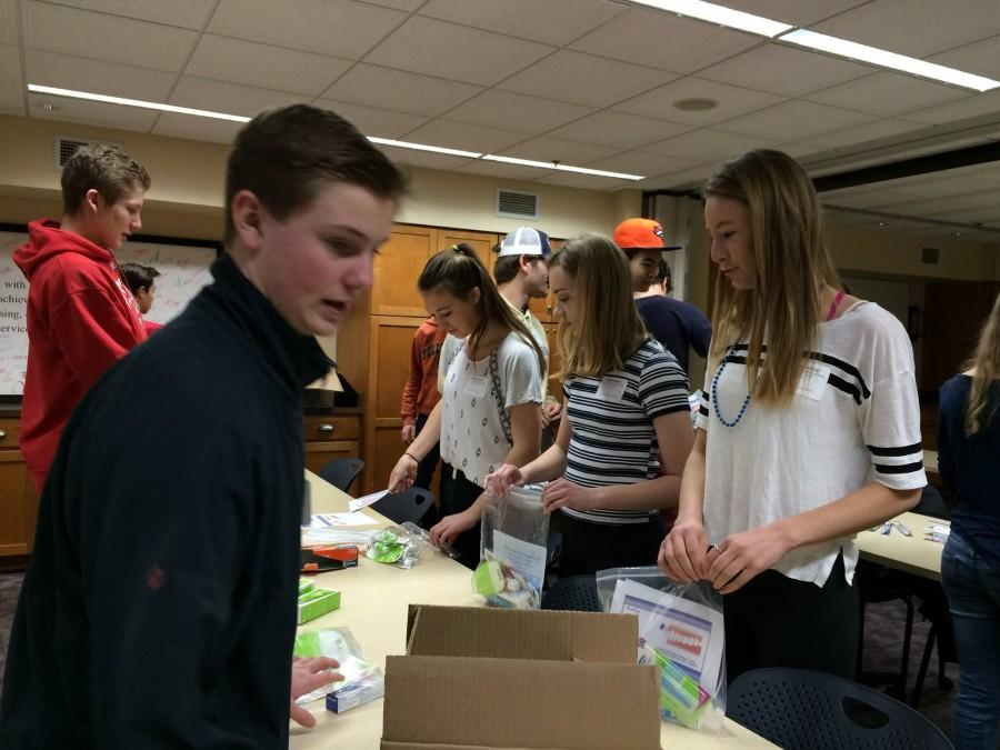 SPA students pack dental hygiene kits containing floss, toothpaste, and more at Project for Pride in Living, one of the nonprofit organizations that that students volunteered at during Service Day.