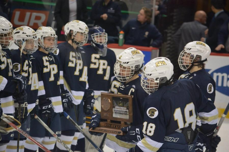 Senior captains Justin Jallen, Evan Dahlseide, and Cullen McCabe accept the fourth place trophy in the Spartan's first trip to the MSHSL state tournament.
