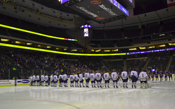 The team lines up before the game after they are announced.