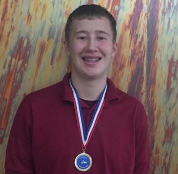 Sophomore Peter Blanchfield wears his medal after his History Bee & Bowl regional competition victory on Feb. 27.  He qualified for the national competition in Washington DC Apr. 22-24.