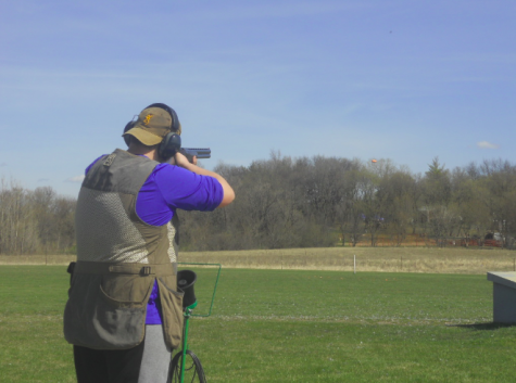 Freshman Riley Tietel takes aim at a clay pigeon during trap practice.