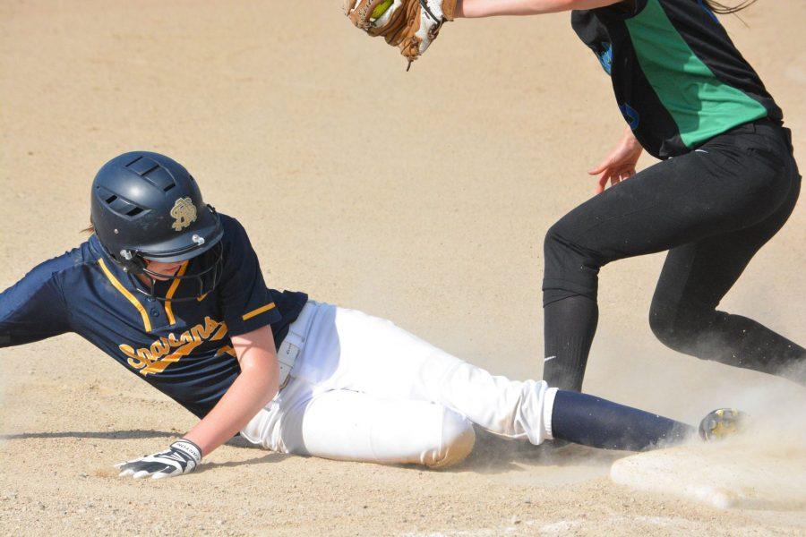 Junior Justine Miller slides into third base.