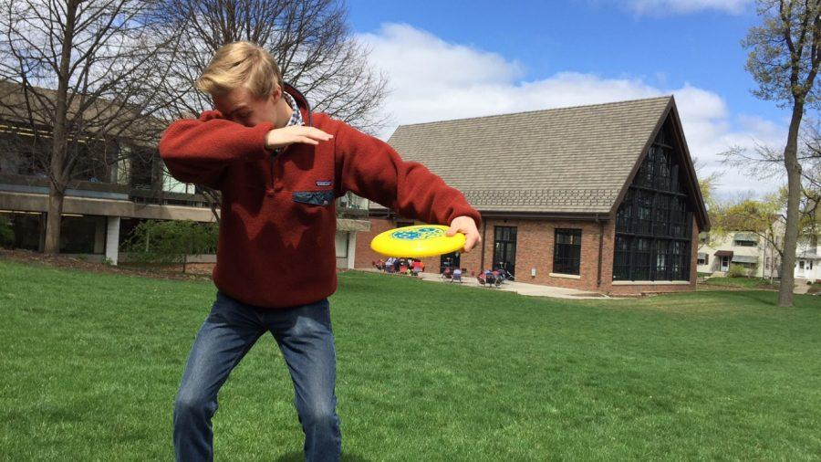 """Senior Cas Burr dabs with a Frisbee. """"Ultimate [Frisbee] is a really good team building sport and at the same time, a very good workout,"""