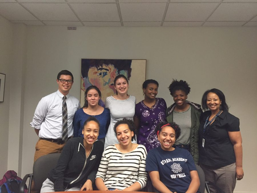 Girls involved in the Black and Brown Girls Affinity Group with Upper school History teacher Ryan Oto and K-12 Diversity Dean Karen Dye.