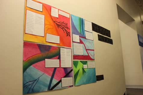 Senior Alena Porter's poster about Sherman Alexie's poetry adds a pop of color to the English wing.