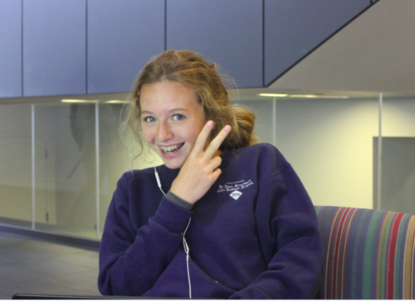 Freshman Muriel Lang works on the newly placed couches by the trophy cases in the Huss Center.