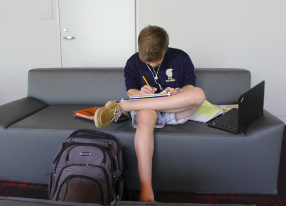 Freshman Nolan Gifford gets work done in the Huss Center for the Performing Arts.