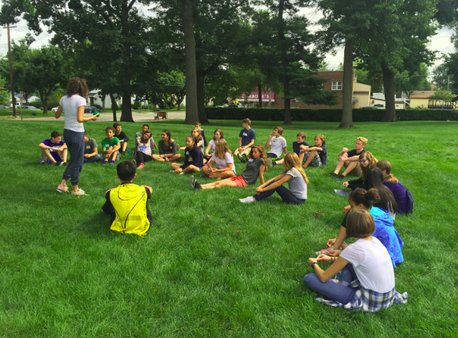 A+group+of+freshmen+listen+to+instructions+for+a+yard+game+at+retreat.+%22We+got+a+super+helpful+tour+of+the+school%2C%22+freshman+Kathleen+Bishop+said.
