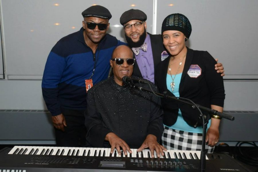 College counseling assistant Aja Parham meets world-famous singer Stevie Wonder. Submitted Photo: