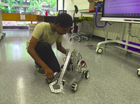 Sophomore Imran Umer works on a robot in the new computer science classroom.