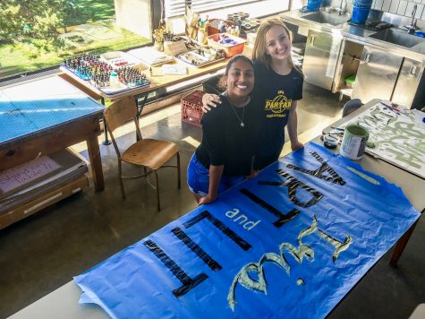 Co-presidents Amodhya Samarakoon (front) and A.M. Roberts (back) work on a poster for the Clubs Fair held on Sept. 15.