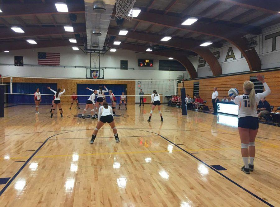 SET, SPIKE, HIT. The Varsity Volleyball team faces off against St. Croix Highschool.