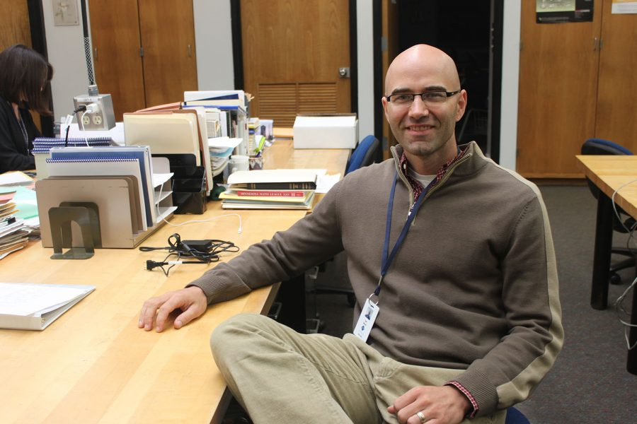 """. UPPER SCHOOL MATHEMATICS TEACHER JOE WARD settles into the math department. """"I'm most excited to learn about and become a part of the culture of the school,"""" Ward said."""