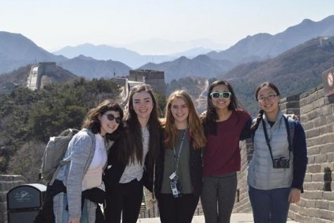 Juniors Mira Zelle and, Allie Verhey, sophomore Gabby Harmoning, and juniors Julia Wang and Sky Li Griffiths pose during a walk on that Great Wall of China during their exchange visit to China over Spring Break.
