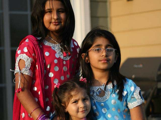 Senior Tabeer Naqvi, and her sisters Mashal and Waffa, pose in their salwar kameez, a traditional Pakistani outfit.