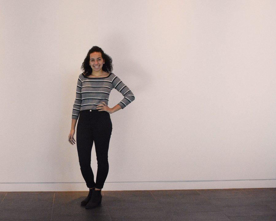 Junior Isabelle Denny keeps it simple with a neutral striped long-sleeved tee and black jeans.
