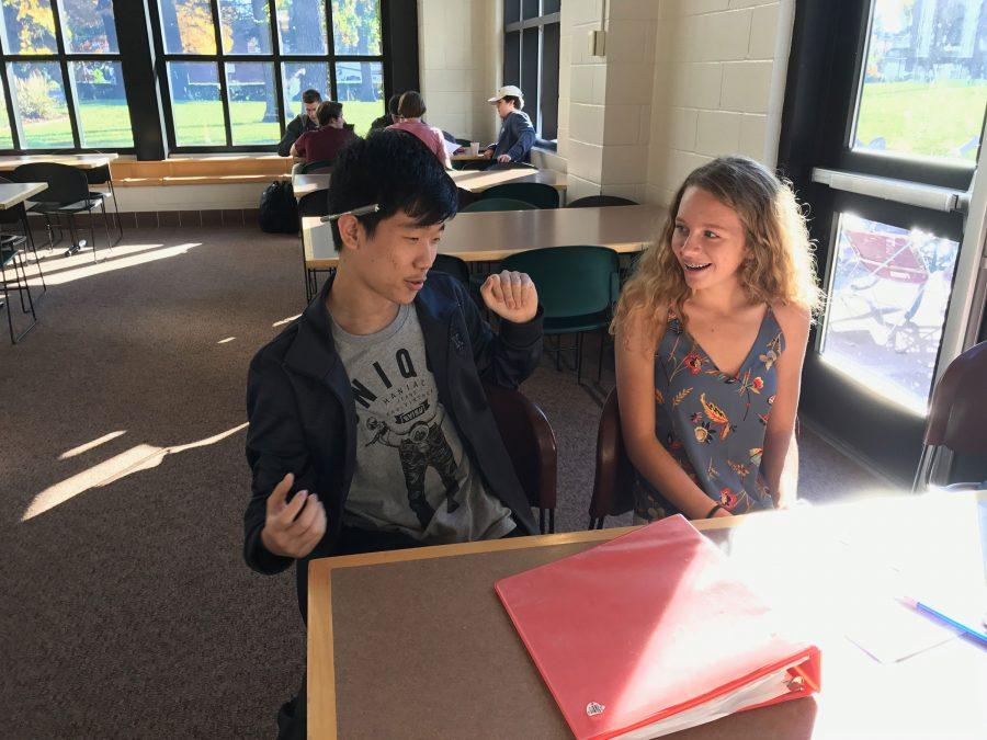 """SOCIALIZING. Allan Wang chats with sophomore Muriel Lang. """"The study hall, I find that long period where you do your homework and finish it all, feels really good. In China, we have to finish all of our homework at home,"""" Wang said."""