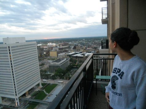 "NEW PERSPECTIVES. Senior Neeti Kulkarni enjoys the view from her balcony in downtown Minneapolis.  ""There's not a feeling like it. You go out and you feel … I wouldn't say you feel powerful because it is really freaky to look down on how many people are there … but it kinda gives you perspective on what's out there and it's just a really surreal feeling to be able to see the entire downtown laid out straight in front of you,"