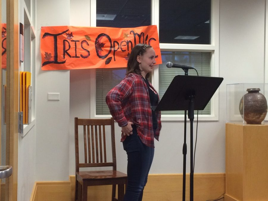 "Ninth grader Anna Snider recites a piece she wrote in the Summit Center during Iris: Art and Literature's first open mic night hosted on Oct. 26. ""I'm really glad that I did it,"" said Snider."