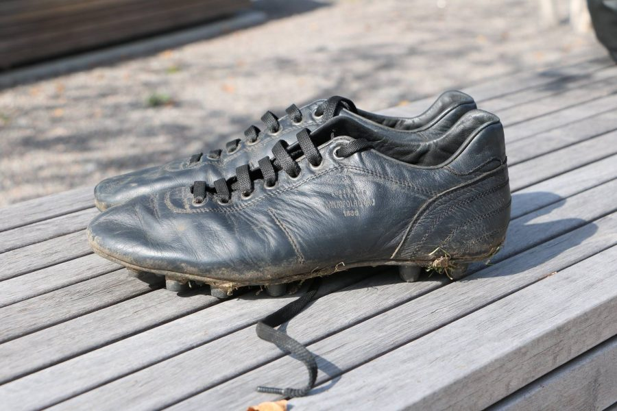 """Sophomore Husaam Qureishy said that he stays away from trendy brands of soccer cleats.  He recently came across an Italian brand, Pantofola D'Oro, that makes leather cleats that are """"good-looking and non-flashy,"""" Qureishy said."""