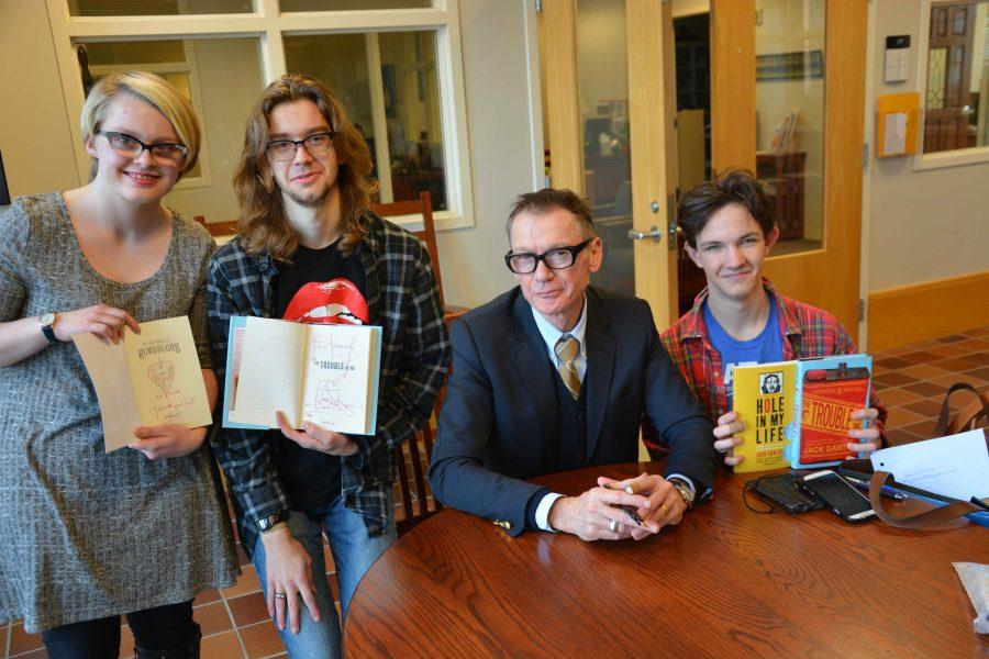 Author Jack Gantos signs books for seniors Ellie Brass, Andrew Michel, and sophomore Ben Atmore after speaking to Upper School students. Of writing, he said,