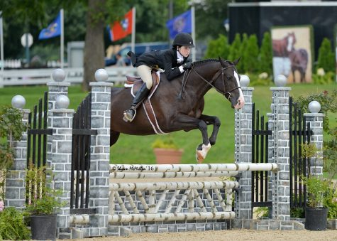 Ninth grader Amelia Batson competes in an over fences round at a horse show in Kentucky.