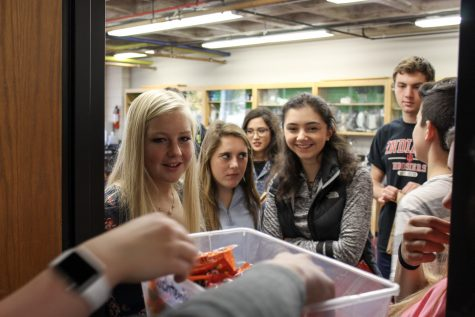 High school students participate in trick-or-treating during advisory