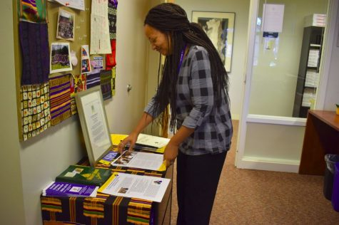 "Upper School Diversity Dean Karen Dye looks over the August Diversity Forum Series training handouts in her office. The upcoming February training aims to give faculty and staff ""more specific tools and strategies about having conversations with students,"" Dye said."