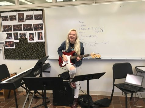 PRACTICE MAKES PERFECT. Senior Emily Schoonover held daily practices in the wind's room with other members of the band to rehearse the songs that would be added.