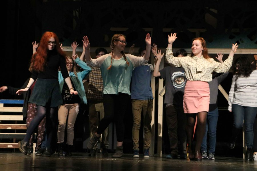 Junior Lillian Pettigrew, 9th grader Quinn Christensen, and sophomore Chloe Morse lead a dance number during tech week of the US Fall Play, As You Like It.
