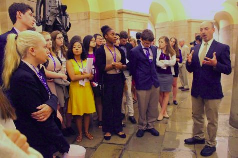 """The 2016 Free Spirit Scholars gather around a tour guide at the White House. """"I'm now more aware of what's out there, so I'm definitely going to take advantage of all the ways I can consume news and read it and watch it,"""" Michigan Free Spirit Scholar Erykah Benson said."""