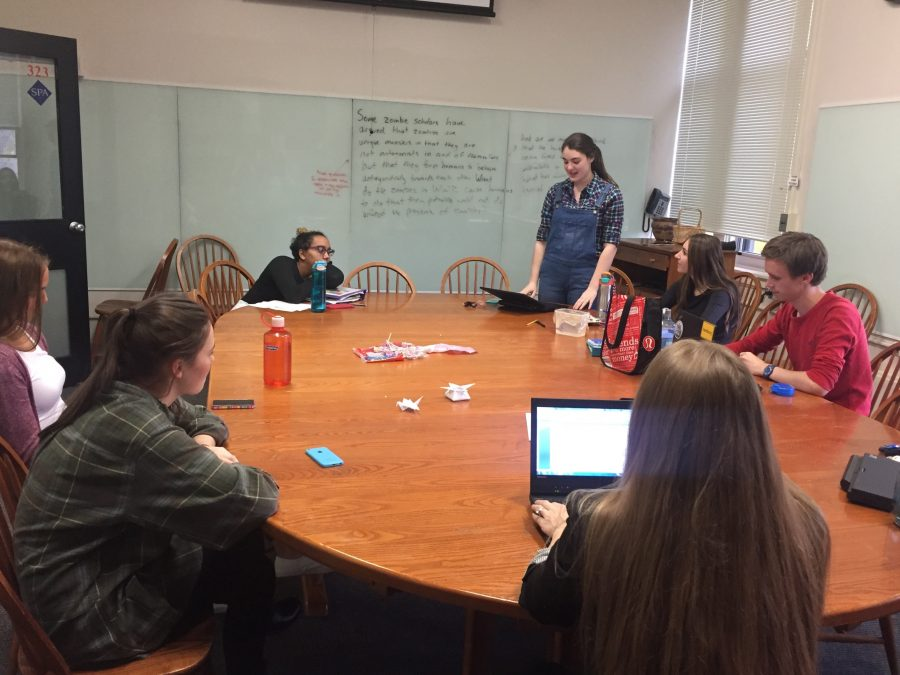 Senior Mary Grant practices reading one of her chosen poems aloud in front of the group.