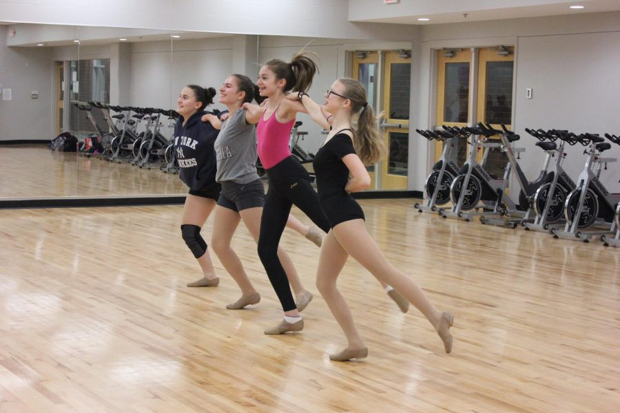 """The dance team this year has made larges changes. Unlike other sports teams, the team has combined with Minnehaha Academy for the first time this season, creating a larger team than they had previously. Because of the change, they also don't have any captains for the first time in over five years. Since Minnehaha just started the team, as a whole they decided that they wouldn't have captains, because it wouldn't be completely fair.    Ninth grader Ellie Hoppe has been on the St. Paul Academy dance team for three consecutive years and was a captain of the team last year. The team was very small in their previous years which is why the team decided to combine with Minnehaha Academy, who had never had a school dance team before.    """"Because we're a co-op with Minnehaha and it's their first year this year, it didn't really seem fair that they didn't have a chance to be a captain,"""" Hoppe said.    """"Becoming a co-op made the team larger and people get there at different times now but practice hasn't really changed that much,"""" Hoppe said.   Ninth grader Annika Findlay was also previously on the team, sees the new change as a positive adjustment and a chance to make new friends. The team was also able to grow close quickly since it is so small and close-knit. They bond as a team easily and bonded by pulling pranks on eachother.    """"This year we're really into pulling pranks on eachother, generally I'd say that we're pretty positive and supportive,"""" Hoppe said. """"We're also a little sassy,"""" Findlay added.   """"[One of our pranks was] in our rehearsal space there's an equipment closet and one time a girl was running late and we all hid in there and we set up a phone on face time so that we could see what was happening and then we jumped out,"""" Hoppe said.   """"We also told one girl that she didn't submit the costume form in time so she wouldn't be able to compete,"""" Hoppe said.   Hoppe and Findlay both agreed that their team members from Minnehaha are all really supportive and nice a"""