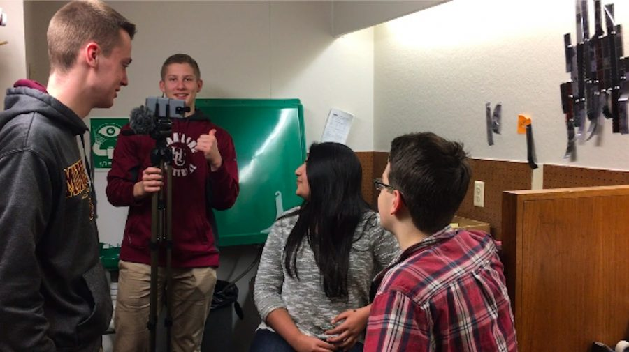 Senior Tommy Dicke works as cameraman for his production group, including seniors Tabeer Naqvi, Ian Scott, junior Ned Laird-Raylor, and 9th grader Peter Michel (seen in the video).