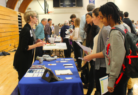 "Organizations with interests ranging local to international tabled in Briggs Gymnasium on Nov. 30 for the first ever Service Fair.  ""The hope of the service fair is to combat against the idea that service is just for sophomores, and to help engage students in all grades in service,'' Community Action and Service advisor Mollie Ward said."