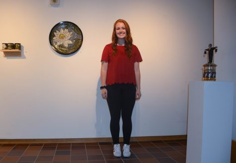 Senior Macy Blanchard combines textures and patterns with a red, suede, scalloped shirt.