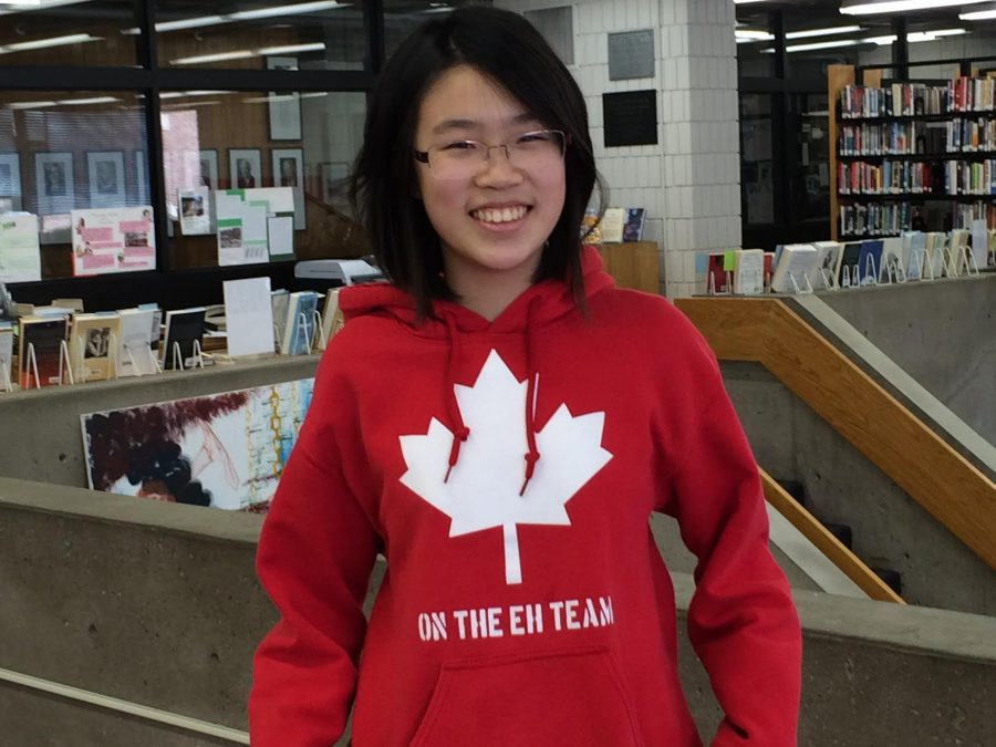 """Both ninth grader Melissa Nies passport and sweatshirt are Canadian. """"Canada is colder and more hippie,"""" Nie said."""