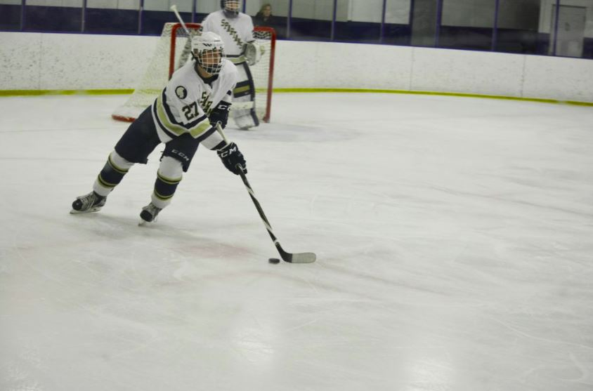Senior defender Noel Parker carries the puck up the ice.