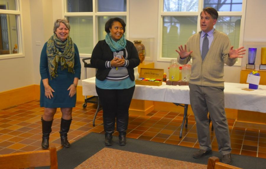Upper School Principal Chris Hughes and then College Counseling Assistant Aja Parham celebrate 17 years of service from former Upper School Assistant Annie Harness.