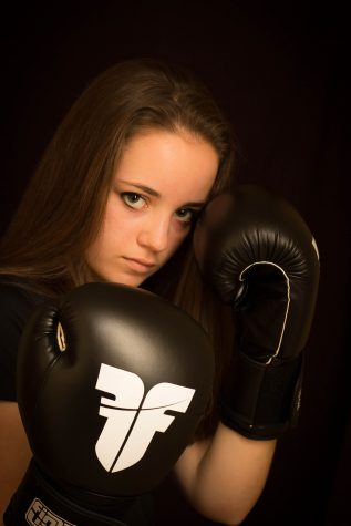 """9th grader Megan Massie boxes in her free time. """"People ask me if I beat other girls. I'm still feminine. I'm aggressive in the sport but not outside."""" Massie said."""
