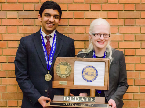 Junior Adnan Askari and senior Sarah Wheaton hold the 2017 State Debate trophy, their second, in the MSHSL competition. knowing that we could still be good enough to meet [that expectation] feels good,