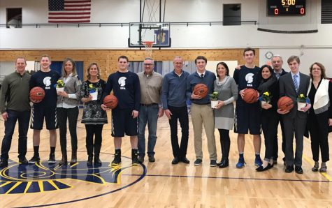 Class of 2017 Spartan boys basketball players stand with their parents before the game: Sam Dicke, Mark Ademite, Emerson Egly, Matthew Jaeger, and manager Jackson Jewett
