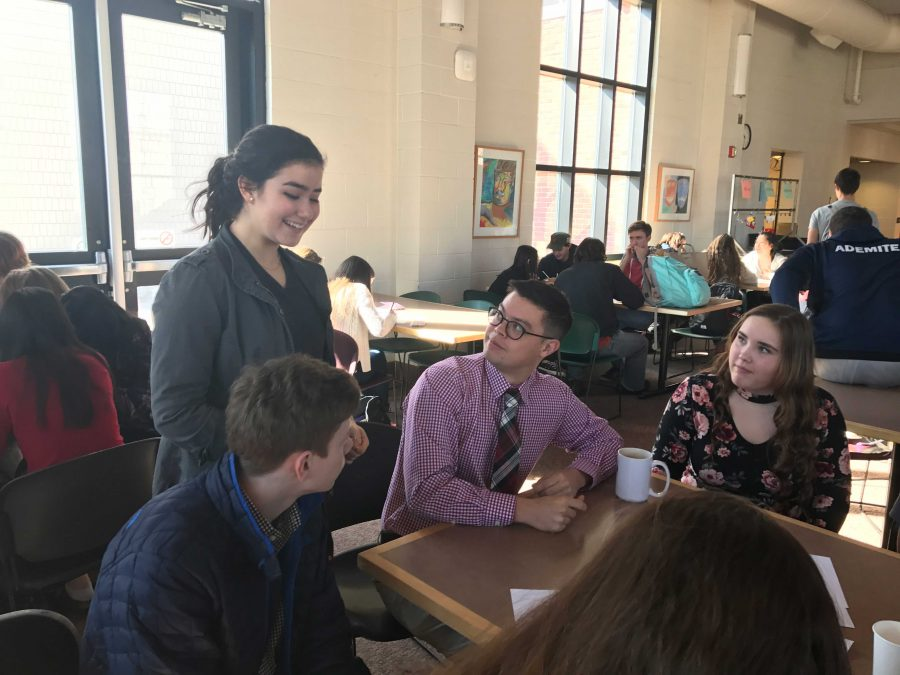 HerSpace co-president, junior Numi Katz,checks in with the Oto advisory, giving them instructions on how to turn in their stickers.