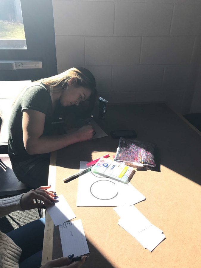 Junior Marlo Graham concentrates on drawing out her design.