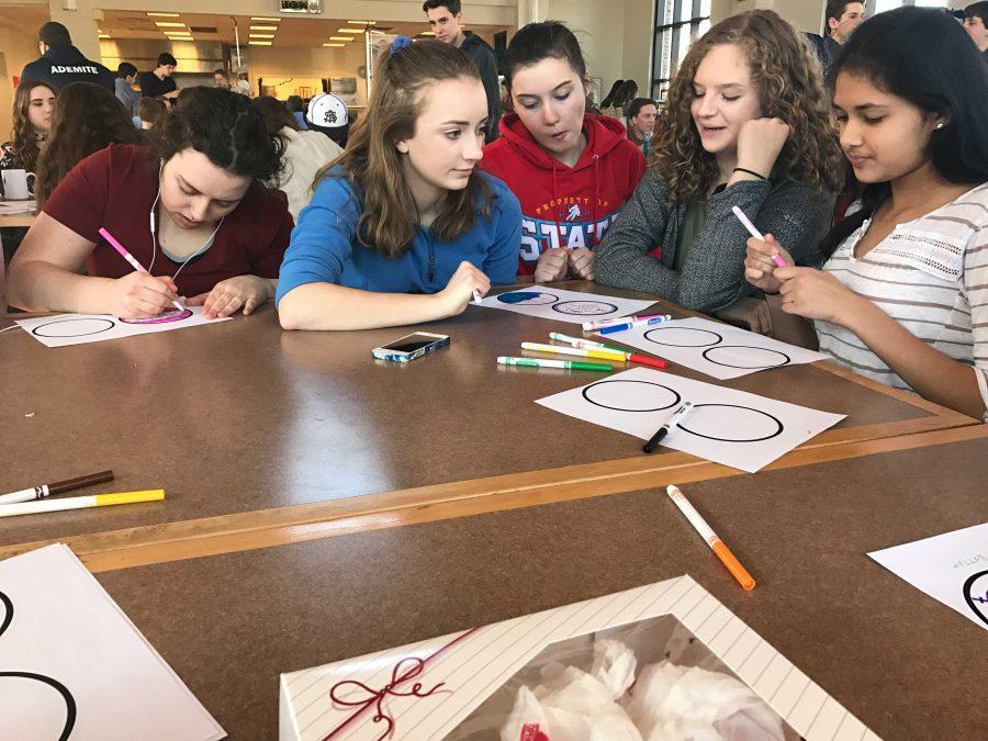 Sophomores Adelia Bergner, Bailey Donovan, Izzy Gisser, and Nitya Thakkar design a sticker together.
