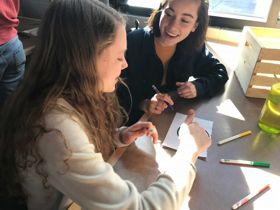 Sophomores Nora Povejsil and Izzy Dieperink collaborate on a sticker design.