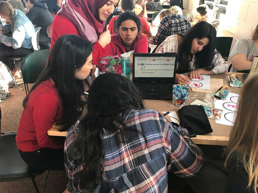 Seniors Amodhya Samarakoon, Stephanie Li, Noor Quiereshy, Sarah Murad, and Tabeer Naqvi work on their feminist stickers.