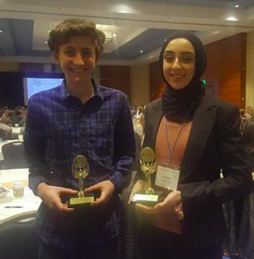 Juniors Iya Abdulkarim and Henry Zeitlow pose with their Seagate emerging scientist awards.