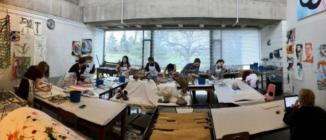Painters filled every table in the art studio with canvases.