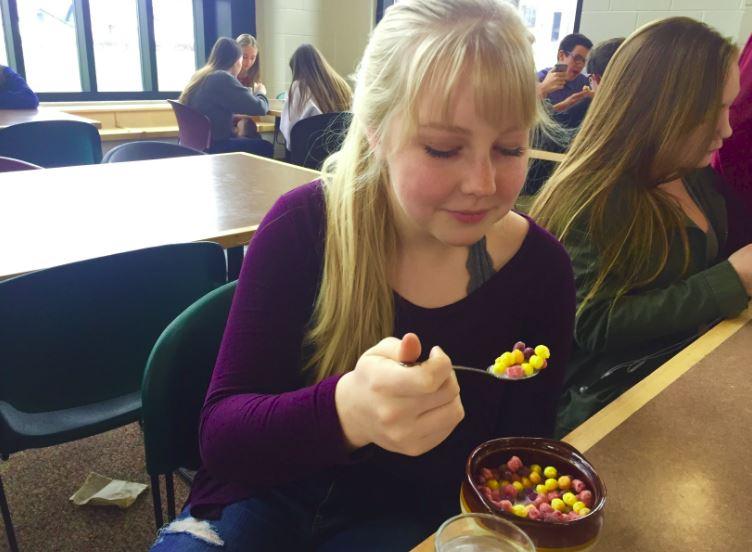 Sophomore Emma Sampson enjoys cereal in the lunchroom.